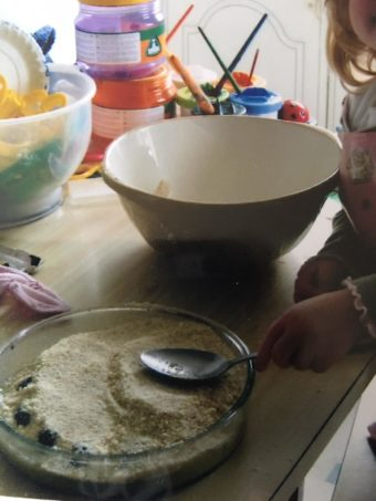 toddler making crumble