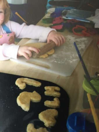 toddler making gingerbread men